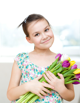 Portrait of the girl with flowers. Spring holiday concept